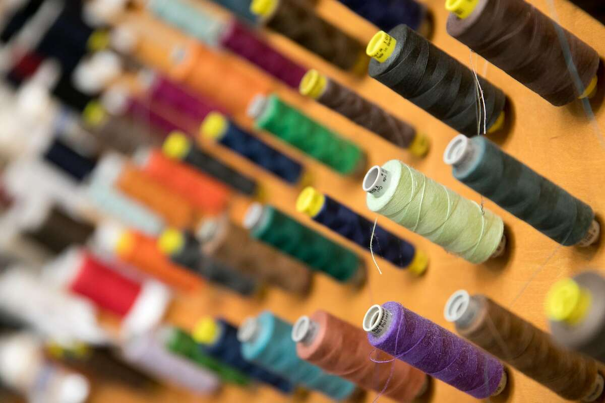 Some of the rolls of thread on the wall at Advanced European Tailoring in Berkeley, Calif., on Dec. 18, 2020. The store served as inspiration for several scenes in Pixar's new animated film
