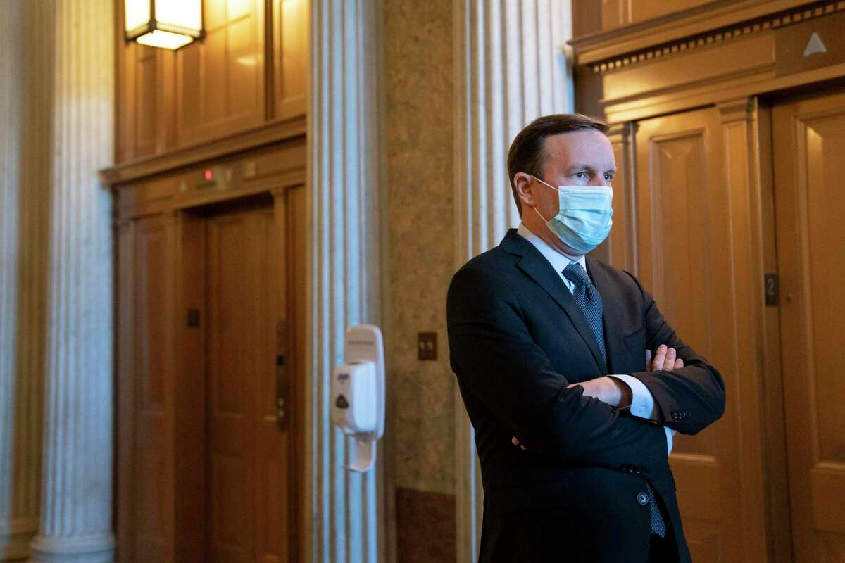 U.S. Sen. Chris Murphy, D-Conn., wears a protective mask while departing the Senate Floor at the U.S. Capitol on Dec.11 in Washington, D.C.