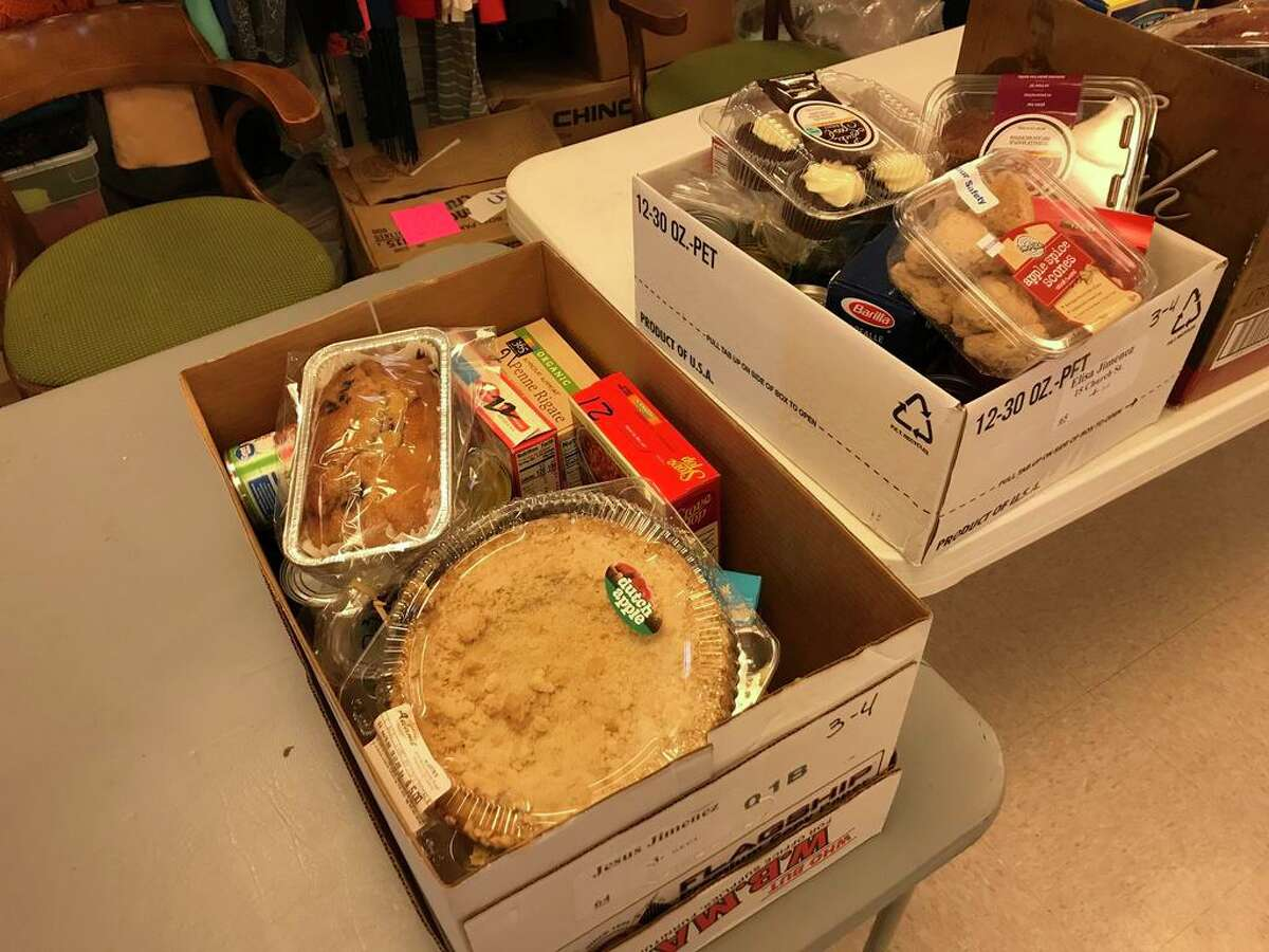 Monday was Distribution Day for 101 residents who received food, gift cards and toys from the Portland Food Bank.