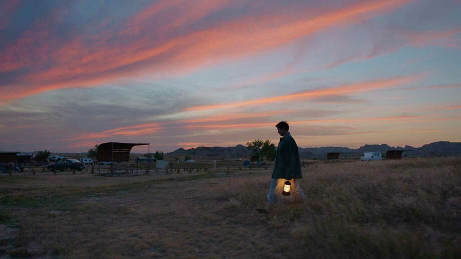 """Frances McDormand makes her way across in a lonely landscape in """"Nomadland,"""" the latest film by Chloe Zhao. Photo: Associated Press, Fox Searchlight / Searchlight Pictures"""