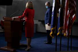WASHINGTON, DC - DECEMBER 20: Senate Minority Leader Chuck Schumer (D-NY) listens as Speaker of the House Nancy Pelosi (D-CA) speaks during a press conference on Capitol Hill on December 20, 2020 in Washington, DC. Republicans and Democrats in the Senate finally came to an agreement on the coronavirus relief bill and a vote is expected on Monday. (Photo by Tasos Katopodis/Getty Images)