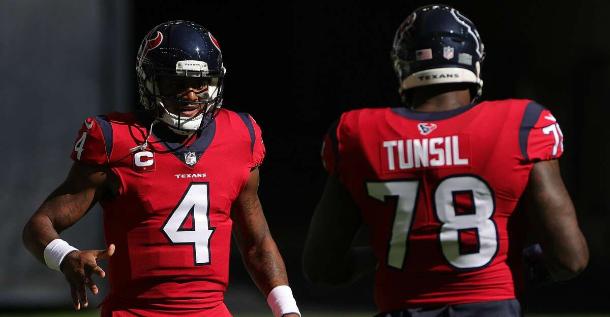 Deshaun Watson #4 of the Houston Texans is congratulated by Laremy Tunsil #78 after scoring an 11-yard rushing touchdown against the Indianapolis Colts during the first half at NRG Stadium on December 06, 2020 in Houston, Texas. (Photo by Carmen Mandato/Getty Images)