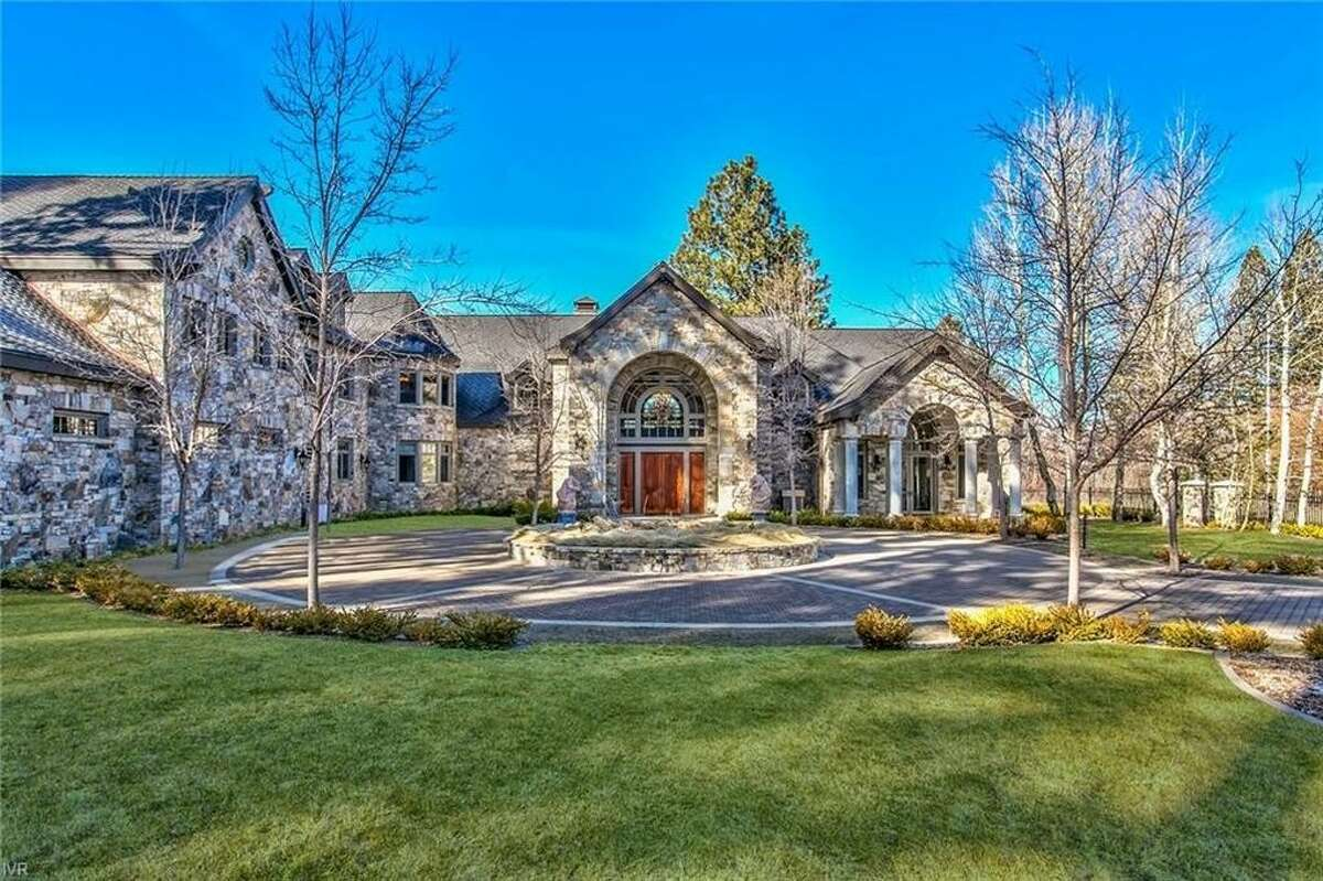 The main home is over 16,000 square feet, composed of over 400 tons of Montana Bluestone. Together with a 1,448 square foot guest house, there are 10 bedrooms and 12.5 bathrooms on the property.