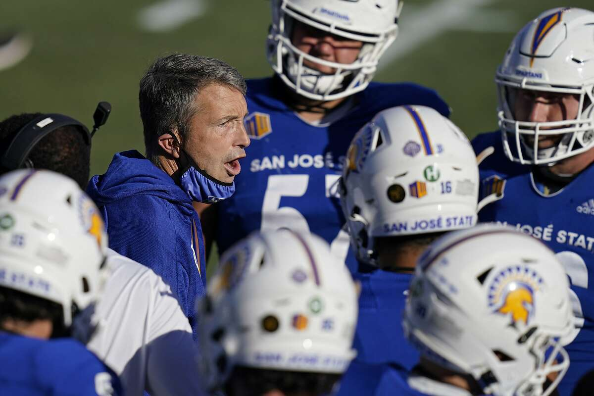 San Jose State head coach Brent Brennan speaks with his players during the first half of an NCAA college football game against Boise State for the Mountain West championship, Saturday, Dec. 19, 2020, in Las Vegas. (AP Photo/John Locher)
