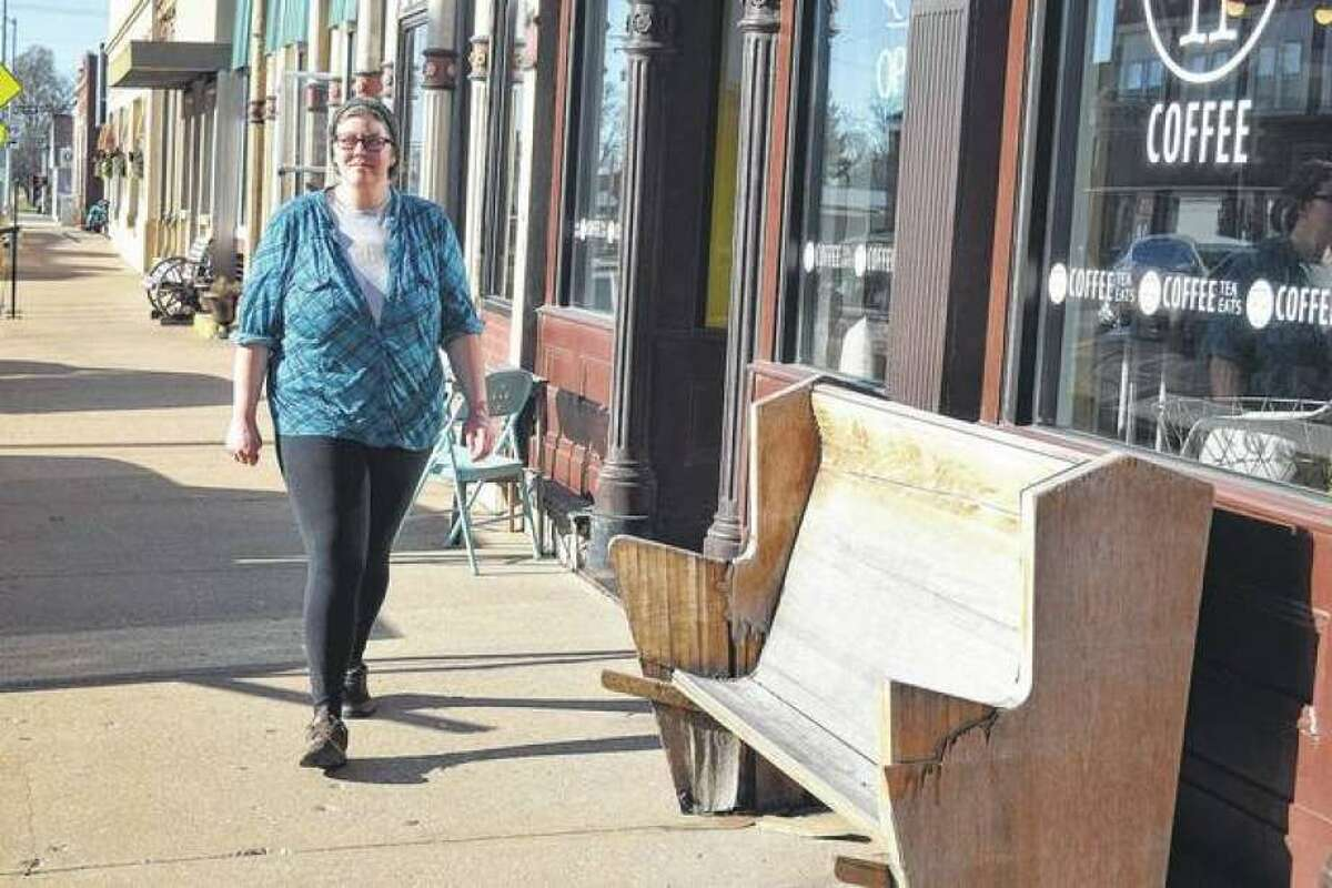 Rachel Yingling of Mount Sterling walks by Free Press Coffee. The shop is one of several businesses that have taken advantage of the Tracy Family Foundation Facade Improvement Program.