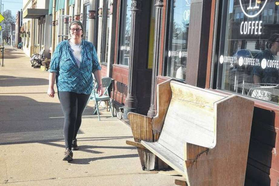 Rachel Yingling of Mount Sterling walks by Free Press Coffee. The shop is one of several businesses that have taken advantage of the Tracy Family Foundation Facade Improvement Program. Photo: Journal-Courier