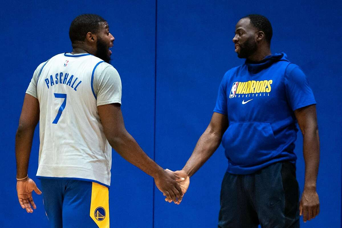 Golden State Warriors' Draymond Green (right) and Eric Paschall (left) at practice at Chase Center in San Francisco, Calif. on Monday, Dec. 14, 2020.