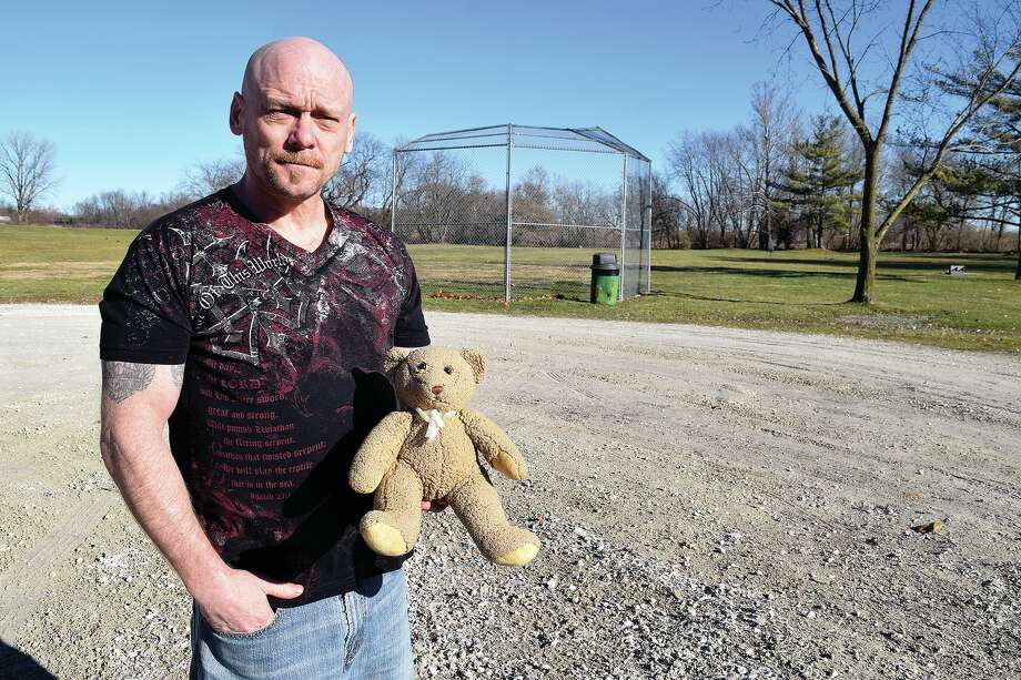 Collin DeLong holds a teddy bear containing an urn and ashes. He found the bear and is looking for the family to whom it belongs. Photo: Samantha McDaniel-Ogletree | Journal-Courier