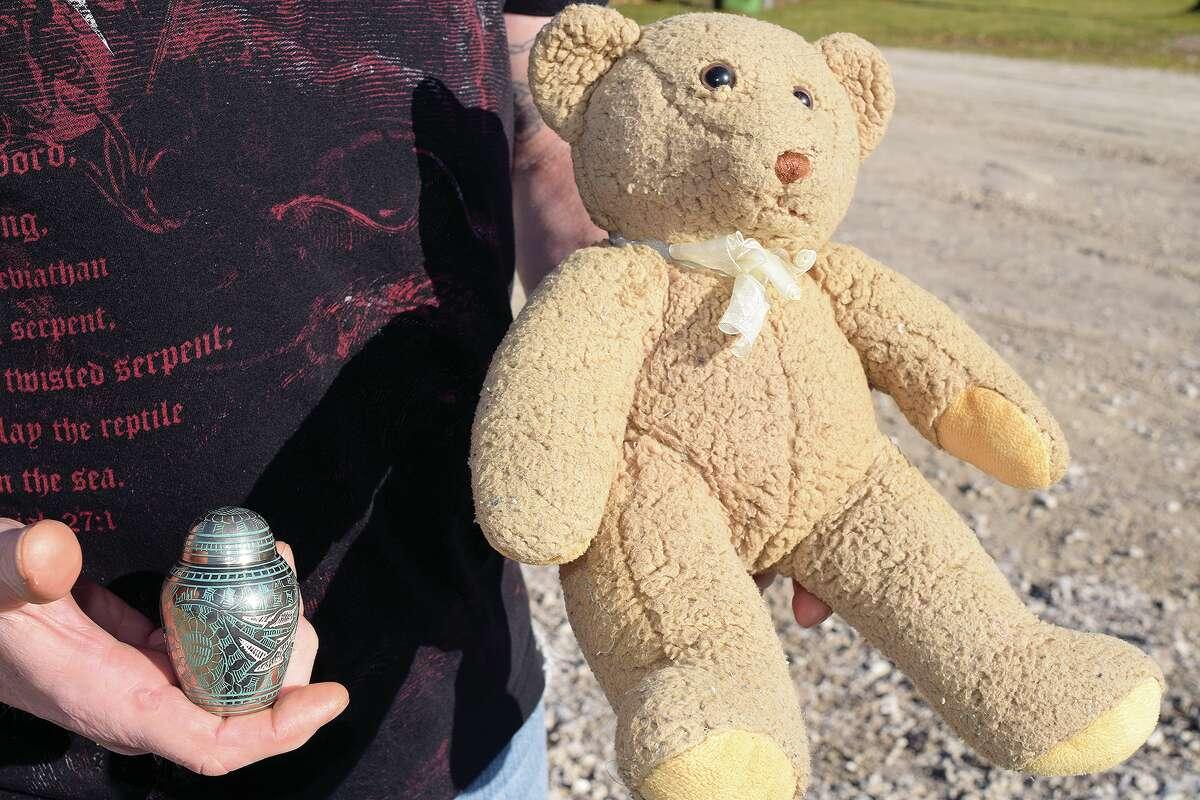 A teddy bear and urn were found Friday near East Morton Avenue.