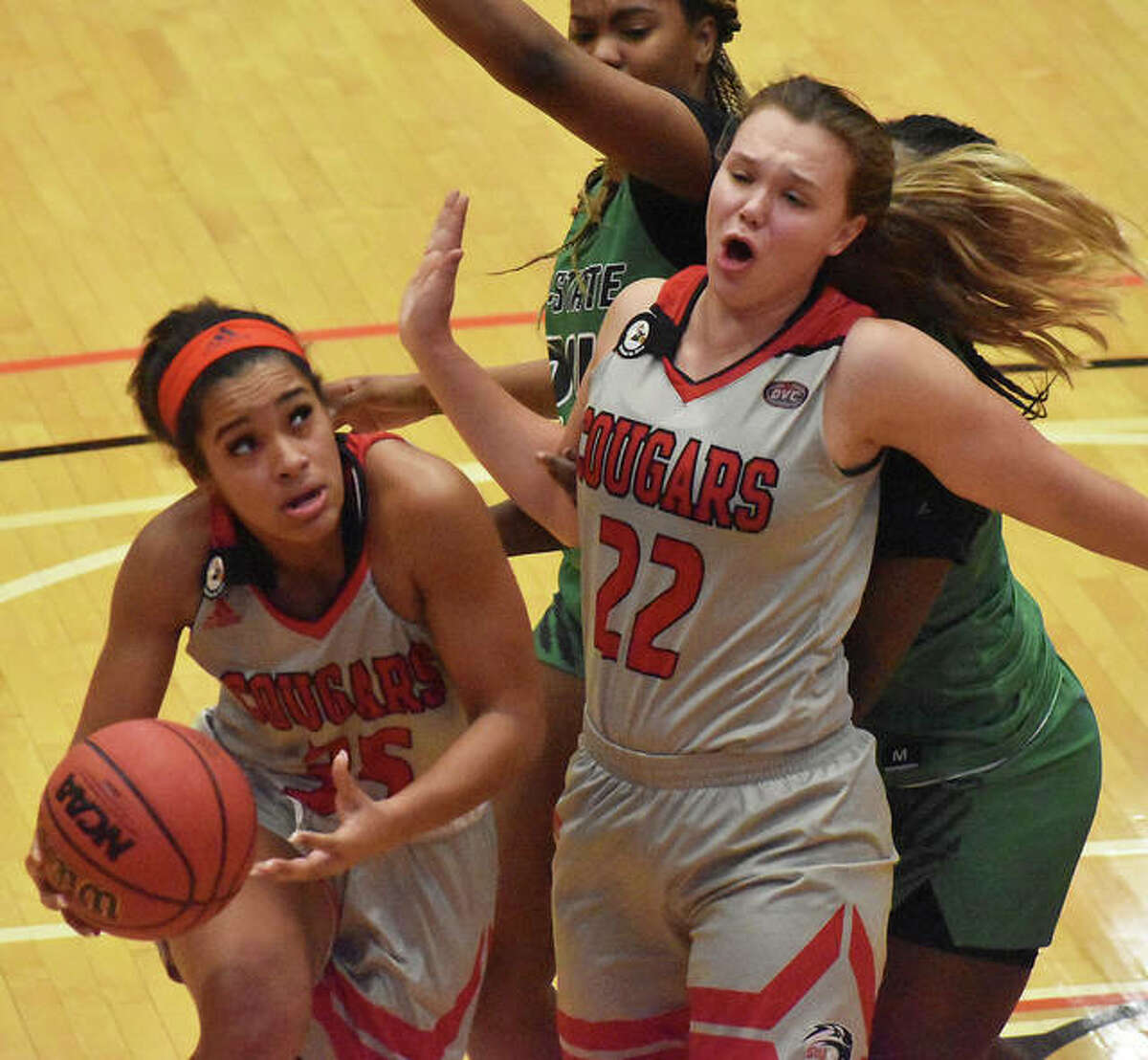SIUE guard Mikala Hall tries to work around a screen from teammate Madison Hackstadt during the first half against Chicago State inside First Community Arena on Monday in Edwardsville.