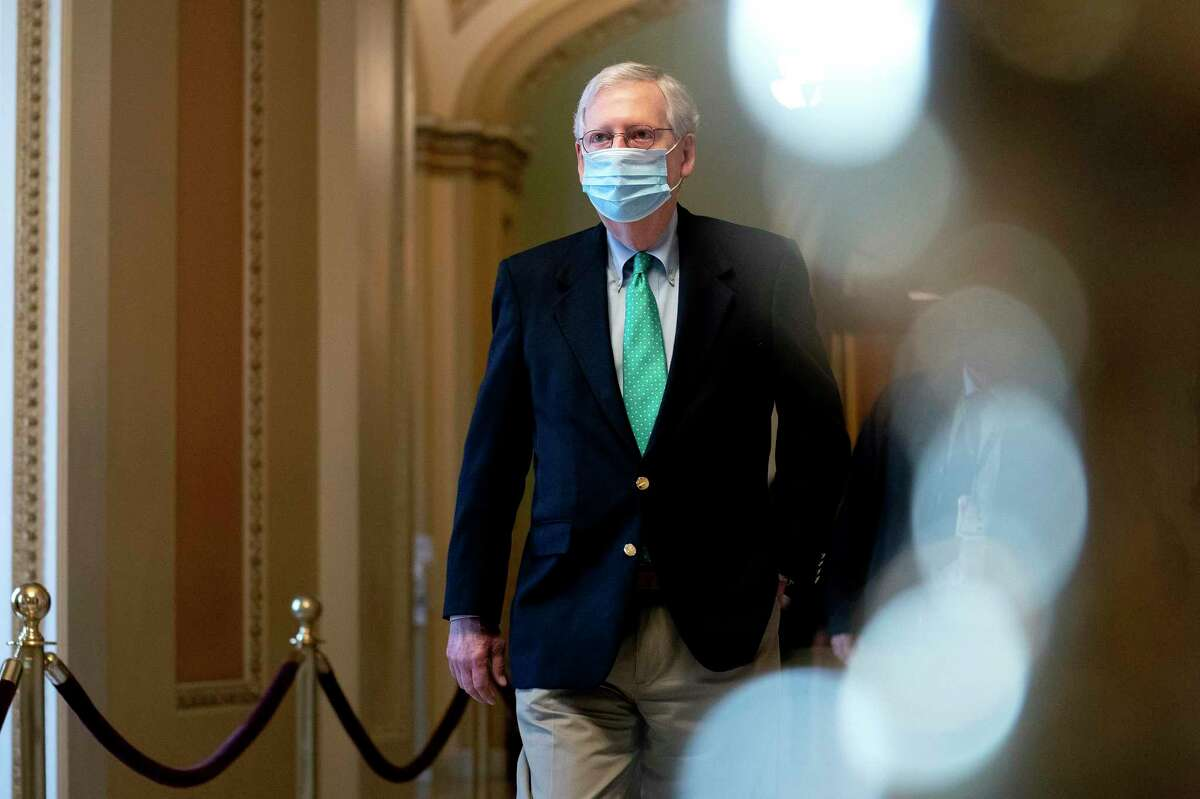 Senate Majority Leader Mitch McConnell (R-Ky.) arrives at the Capitol in Washington on Saturday, Dec. 19, 2020. (Stefani Reynolds/The New York Times)