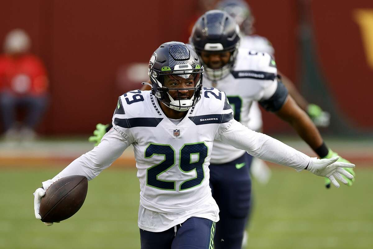 LANDOVER, MARYLAND - DECEMBER 20: Free safety D.J. Reed #29 of the Seattle Seahawks celebrates after intercepting a Washington Football Team pass in the second half at FedExField on December 20, 2020 in Landover, Maryland. (Photo by Tim Nwachukwu/Getty Images)