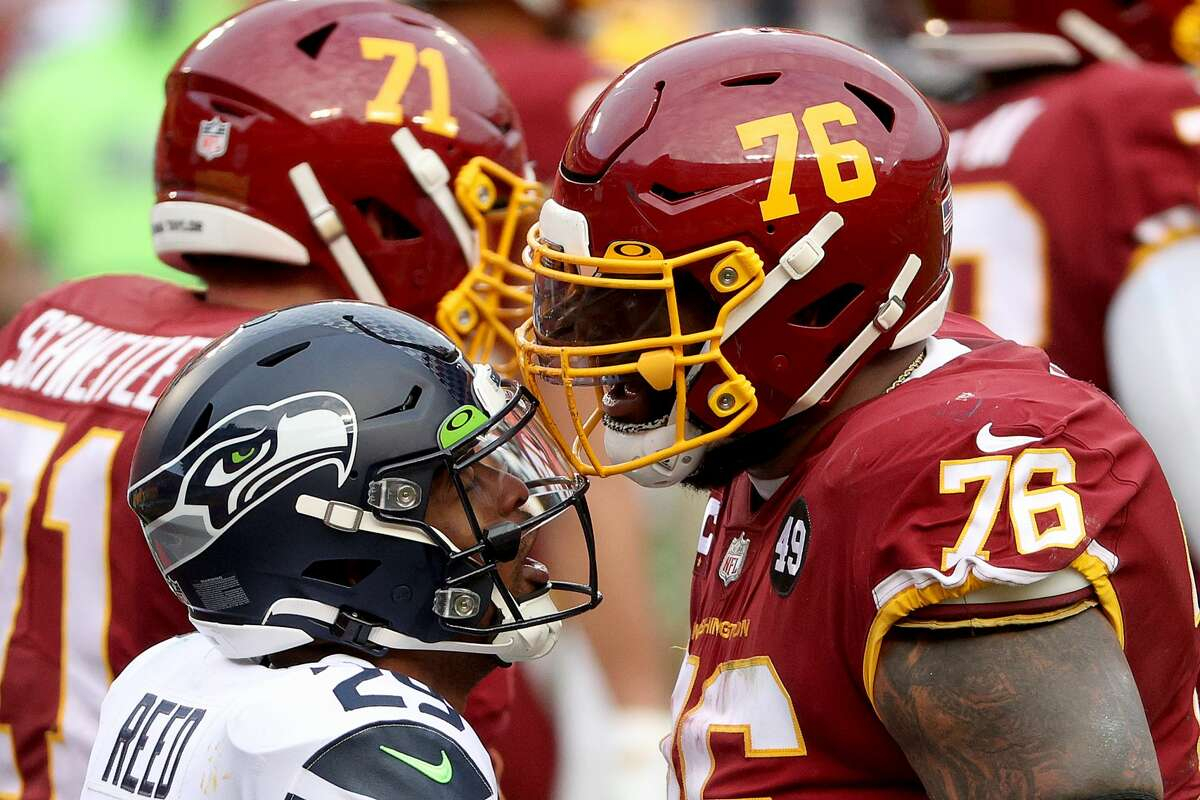 LANDOVER, MARYLAND - DECEMBER 20: Free safety D.J. Reed #29 of the Seattle Seahawks and offensive tackle Morgan Moses #76 of the Washington Football Team exchange words in the second half at FedExField on December 20, 2020 in Landover, Maryland. (Photo by Patrick Smith/Getty Images)