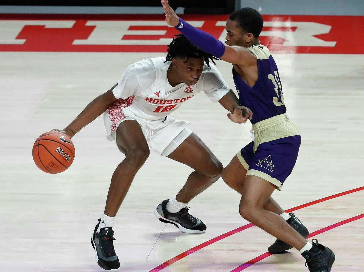 Because UH had only nine players available, freshman guard Tramon Mark, left, saw extensive playing time in Sunday's 88-55 victory over Alcorn State at Fertitta Center.