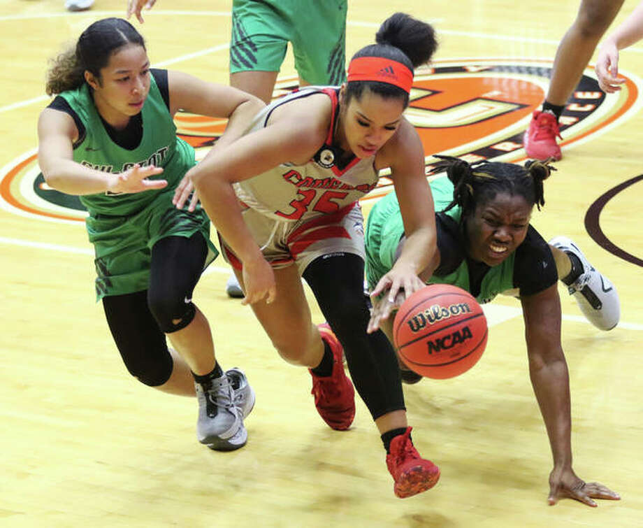 SIUE's Mikala Hall (middle) beats Chicago State's Ifunaya Okoye (right) and Aja Phoumiphat to the ball after it was knocked away Monday in a college women's basketball game at First Community Arena in Edwardsville. Photo: Greg Shashack / The Telegraph