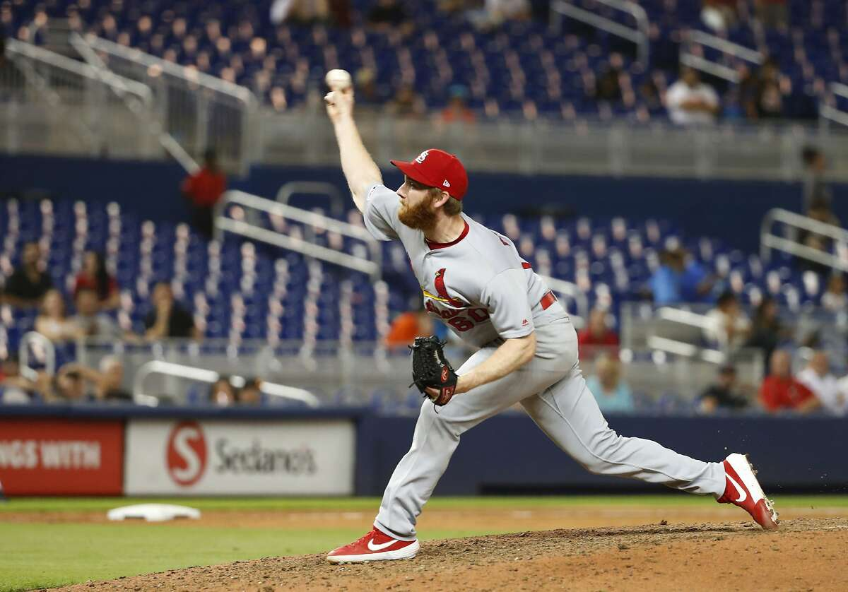 St. Louis Cardinals' John Brebbia delivers a pitch during the ninth inning of the team's baseball game against the Miami Marlins, Tuesday, June 11, 2019, in Miami. The Cardinals defeated the Marlins 7-1. (AP Photo/Wilfredo Lee)