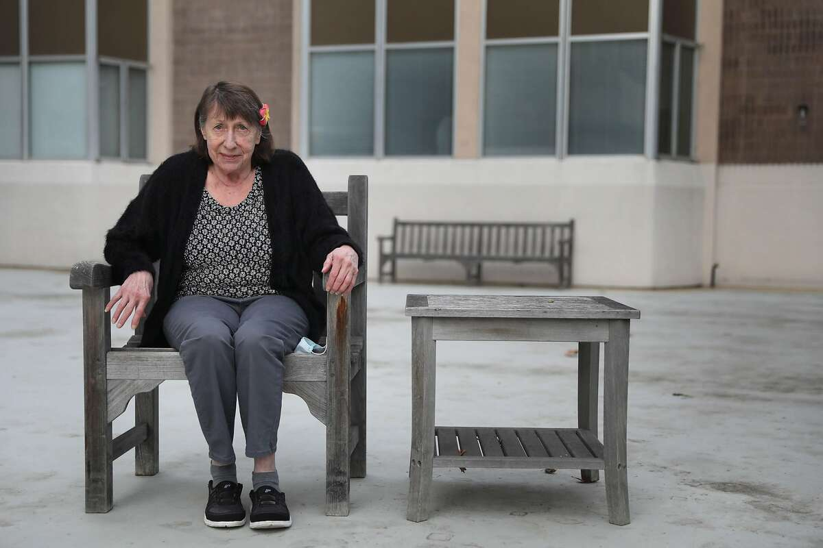 Monika Donovan, San Carlos resident, who received summer rental assistance from the Chronicle's Season of Sharing Fund, sits for a portrait outside the apartment building where she lives in a studio apartment on Wednesday, December 16, 2020 in Belmont, Calif.