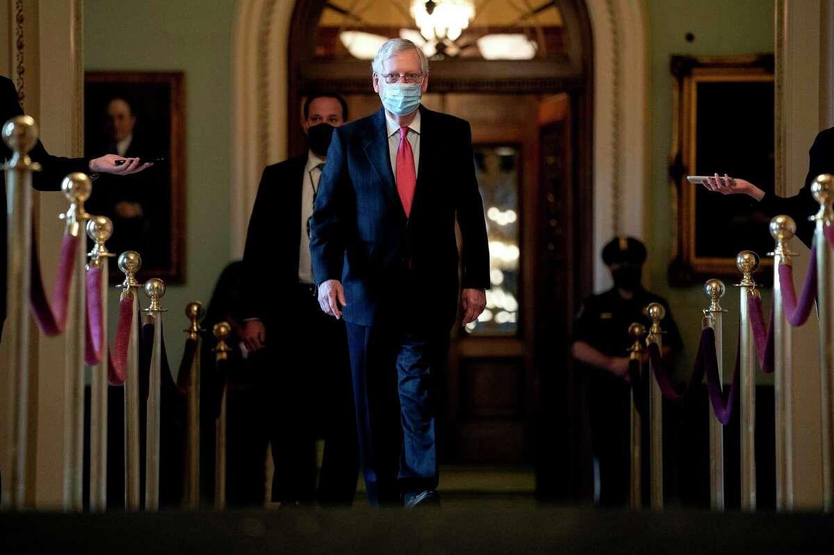 Senate Majority Leader Mitch McConnell (R-Ky.), walks to his office at Capitol in Washington on Monday, Dec. 21, 2020. Lawmakers struck a $900 billion stimulus compromise on Sunday, after months of warnings from economists, corporate leaders and the Fed that the U.S. economy needed additional help. (Stefani Reynolds/The New York Times)