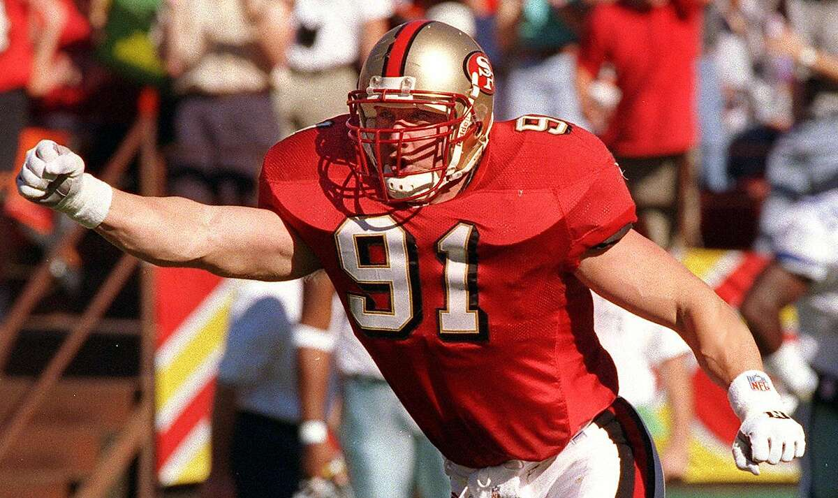 Kevin Greene celebrates a sack against the Cowboys during his lone season with the NFC West champion 49ers in 1997.