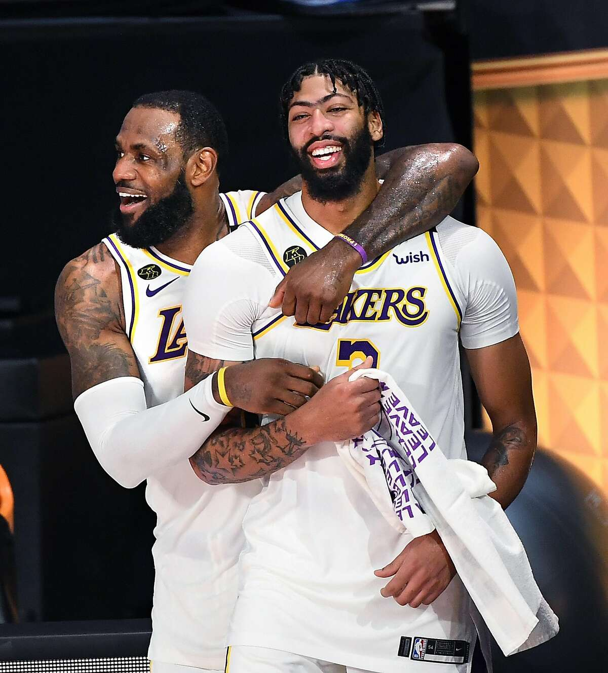 LeBron James (left) and Anthony Davis celebrate the Lakers' championship win over the Heat in October.