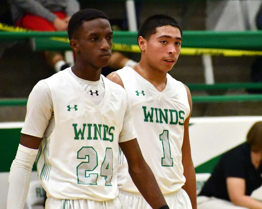 Seniors Desmond Wickware (24) and Quincy Gonzales have the Floydada boys basketball team heading in the right direction after a late start to the season. Photo: Nathan Giese/Planview Herald