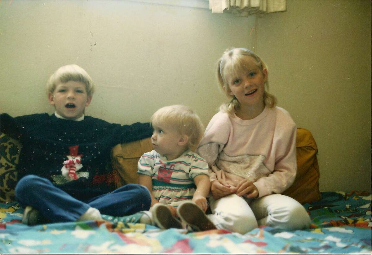 Michaela Garecht (right) in an undated family photo with younger sister, Libby and younger brother, Alex.