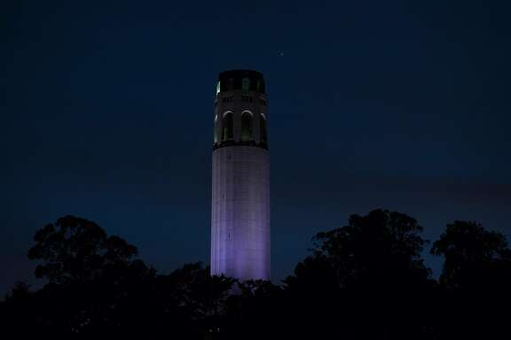 """Jupiter and Saturn are seen with Coit Tower in the foreground in San Francisco, Calif., on Monday, December 21, 2020. The two planets reached their """"great conjunction"""" which is the planets' closest encounter in almost 400 years on Monday. The visual observed distance in the sky between two planets was a mere tenth of a degree, or 6 arcminutes, apart."""