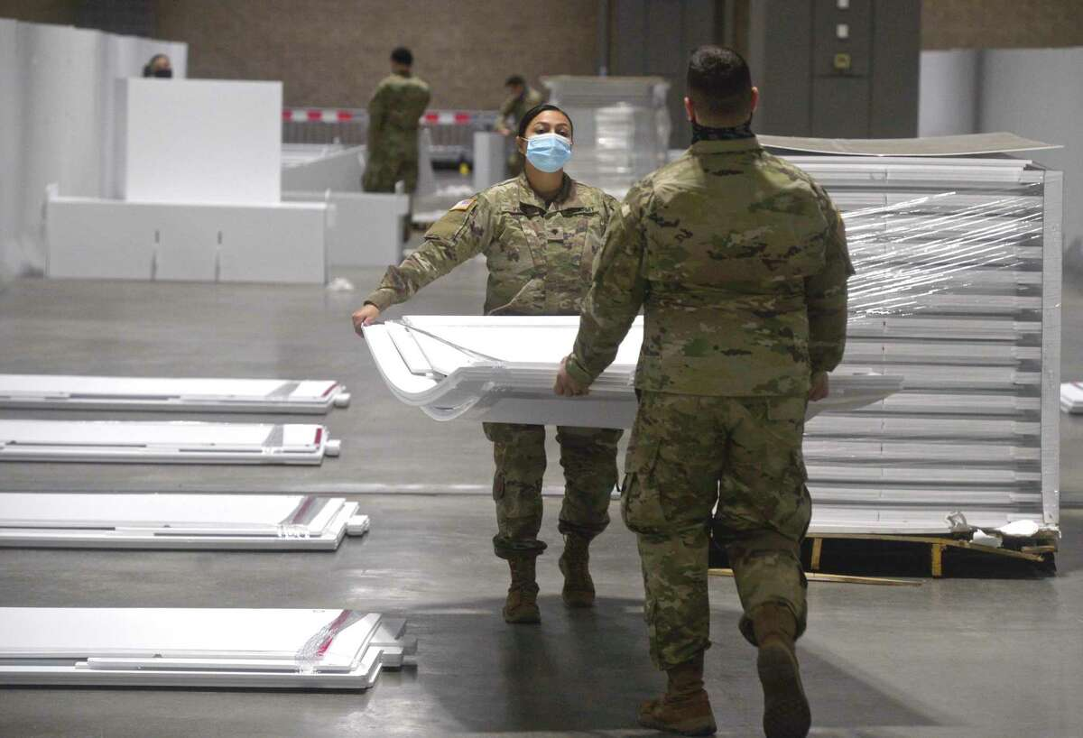 Spc. Samantha Pozo, left, of Danbury, and Spc. Daniel Lovallo, of West Haven, were part of the Connecticut National Guard setting up a field hospital at the Connecticut Convention Center in Hartford. Hartford HealthCare will be operating the site.