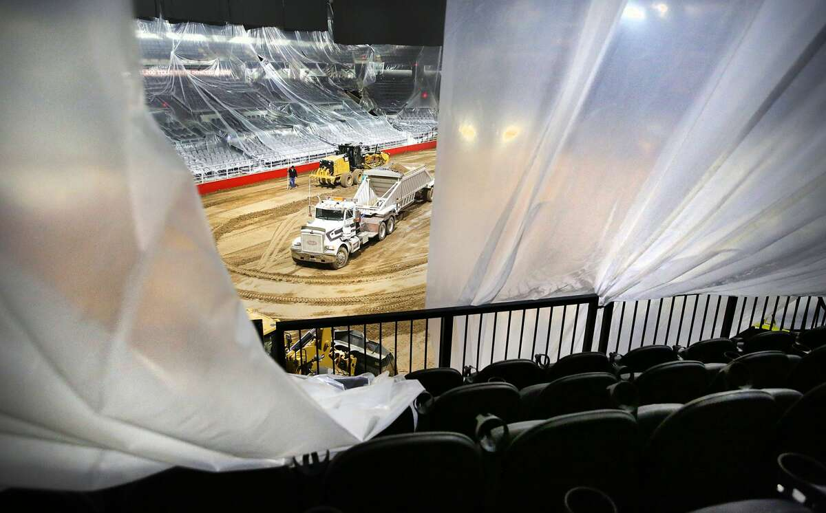 Dirt is spread across the AT&T Center floor in preparation for the San Antonio Stock Show & Rodeo.