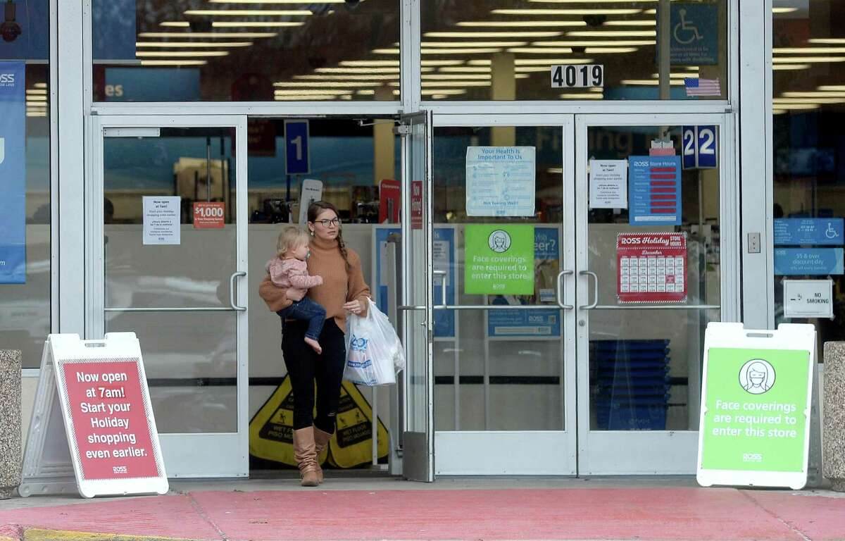 Shoppers make their way out of Ross in Beaumont Monday as area retailers and restaurants continue to encourage masks while in the premises, particularly as case numbers remain high. Photo taken Monday, December 14, 2020 Kim Brent/The Enterprise