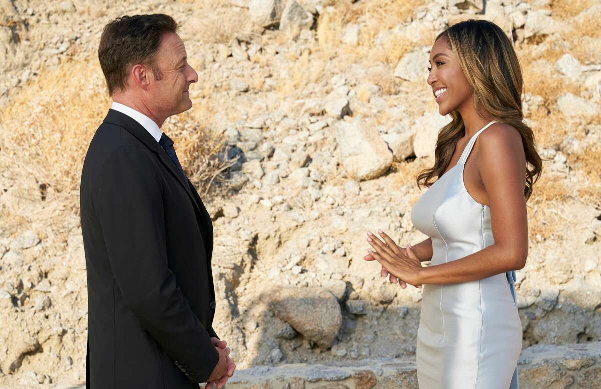 Tayshia Adams, shown here with the perpetually grinning Chris Harrison, is supposed to pick her future husband on Tuesday night's season finale of