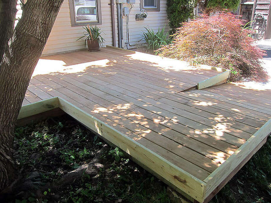 """This is the """"after"""" picture of a project that Rebuilding Together Southwest Illinois did this year for a homeowner to repair his deck and build two ramps, so he has a safe way out of his house. Photo: For The Intelligencer"""