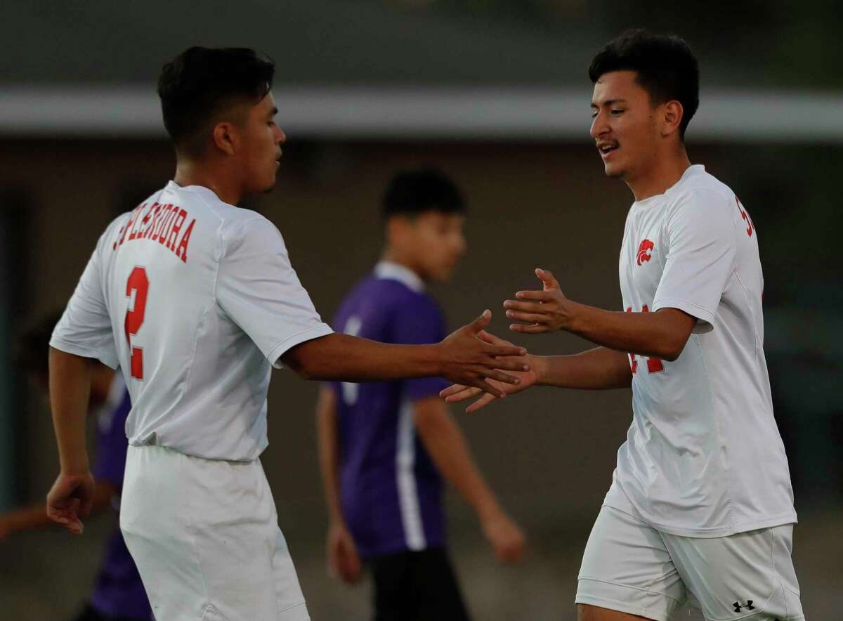 Splendora's Gabriel Rodriguez (2) reacts with Hector Villegas (14) after his goal ties the match 1-1 in the first period during the Wildkat Showcase, Saturday, Jan. 4, 2020, in Willis.