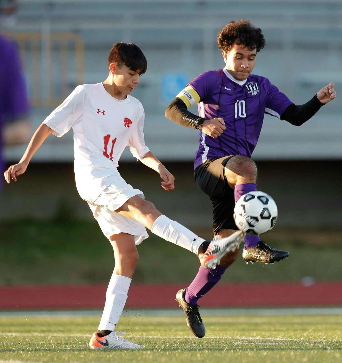 Willis' Ivan Ramirez (10) contests the ball against Splendora's Baruc Delgado (11) in the first period of a high school soccer match during the Wildkat Showcase, Saturday, Jan. 4, 2020, in Willis.