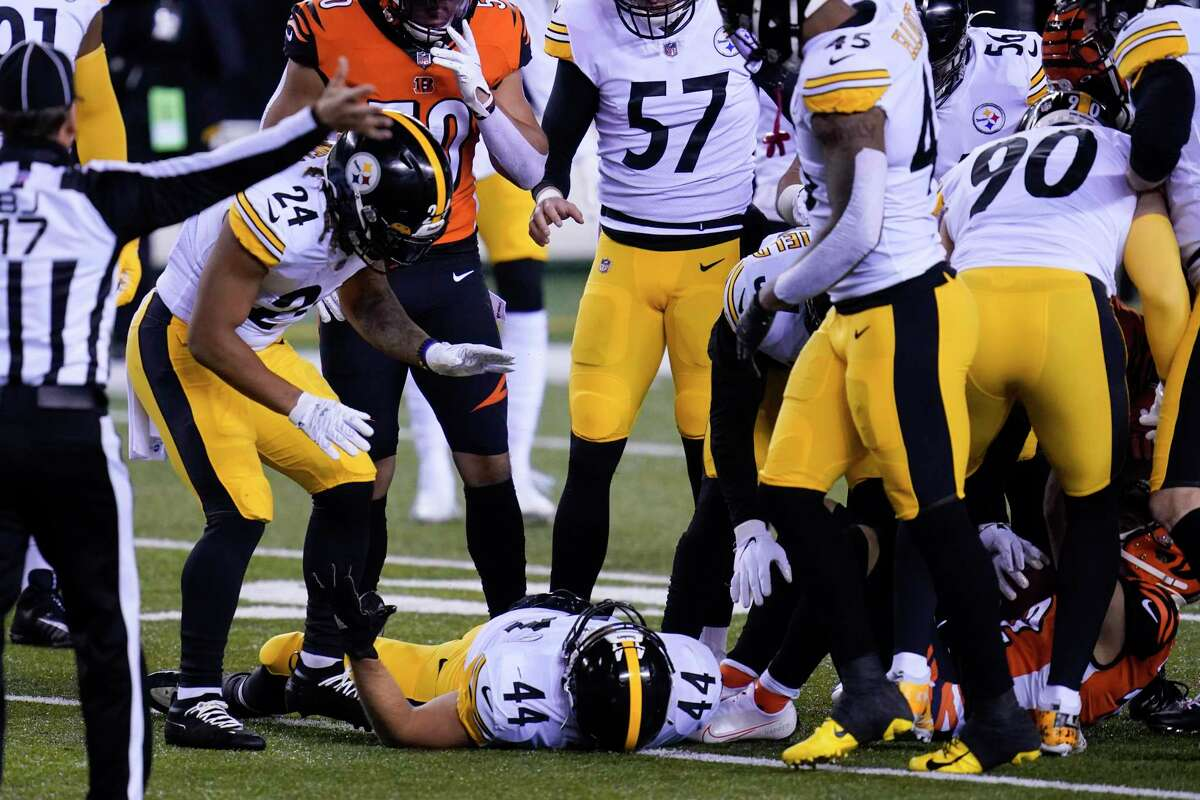 Teammates look at Pittsburgh Steelers' Derek Watt (44) is during the first half of an NFL football game against the Cincinnati Bengals, Monday, Dec. 21, 2020, in Cincinnati. (AP Photo/Michael Conroy)