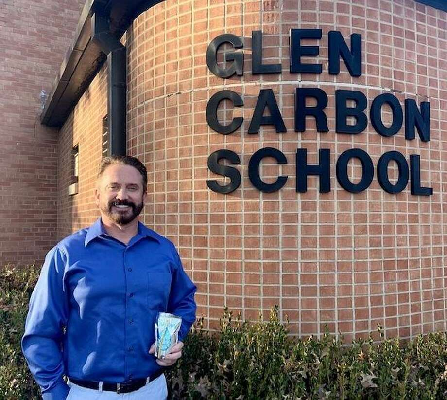 Kraft Heinz employee Jeff Garde stands in front of Glen Carbon Elementary School after helping deliver a donation of water-filled Capri Sun pouches. Garde, a Glen Carbon resident, has children who were once students at the elementary school. Photo: Courtesy Of Kraft Heinz