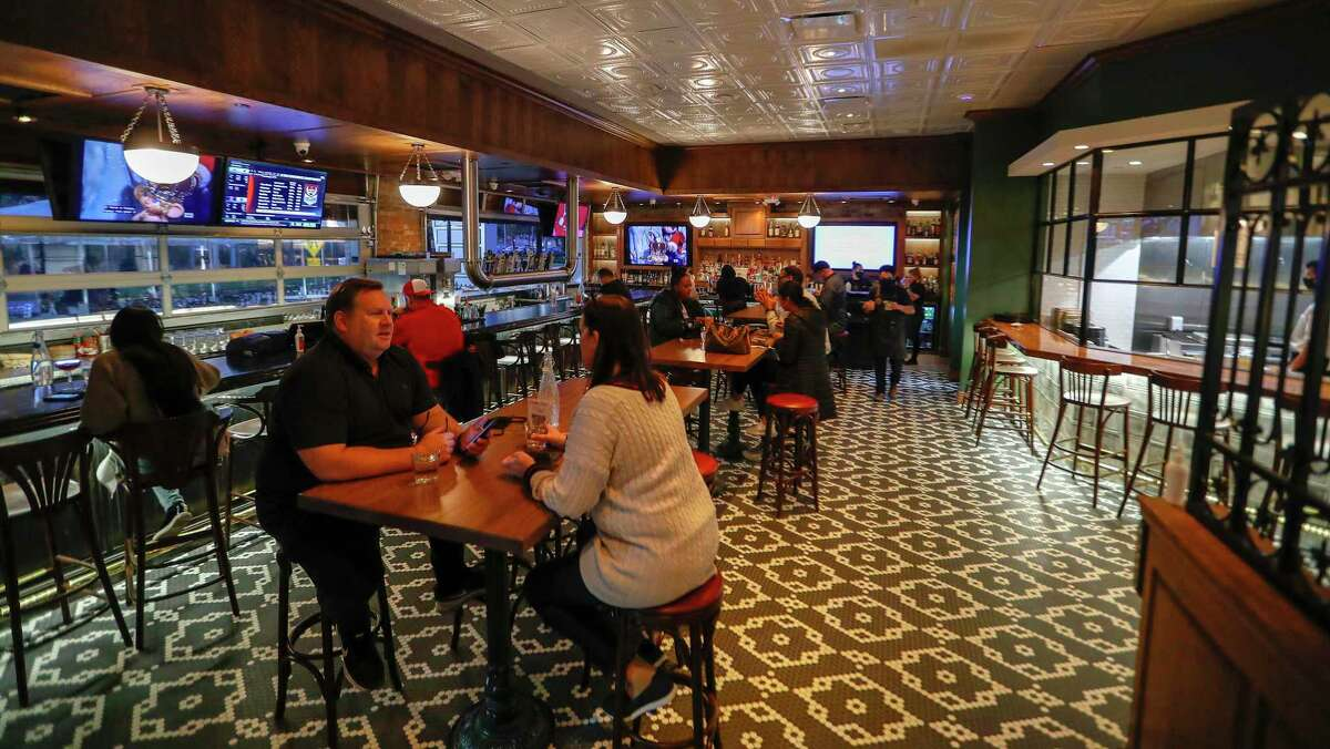 The interior bar area at Acadian Coast, a new Cajun and Creole Gulf Coast seafood restaurant with a huge front patio.