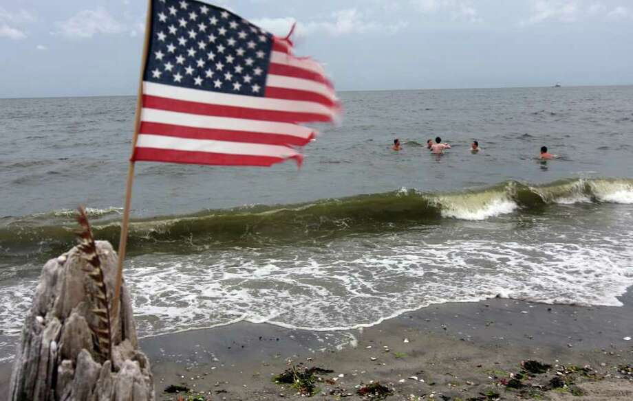The brunt of Hurricane Earl decided not to pummel Connecticut like predicted on Friday, September 3, 2010. Penfield Beach in Fairfield, Conn., brought out many people to enjoy the water and beach even though winds and waves were high.  Here, some Fairfielders decided to brave the choppy waters of the Long Island Sound. Photo: Christian Abraham / Connecticut Post