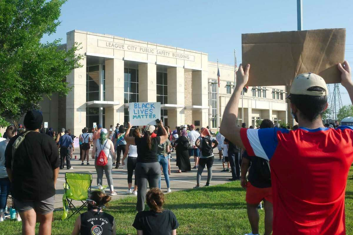 Residents of League City and surrounding communities gather at the League City Public Safety Building in June to protest the police killing of a black man named George Floyd in Minneapolis. City officials including Mayor Pat Hallisey attended the event.