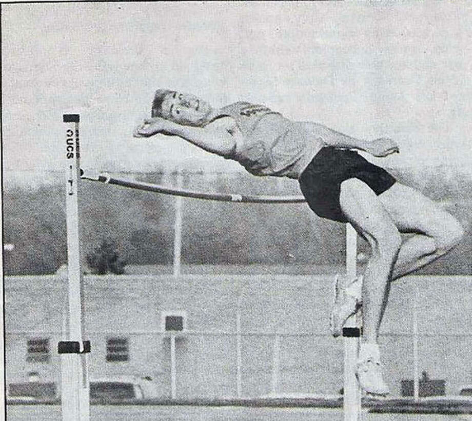 Edwardsville's Justin Range clears 6-5 on his way to winning the high jump at the Madison County Red Division meet during his senior year in 1993. Photo: For The Intelligencer