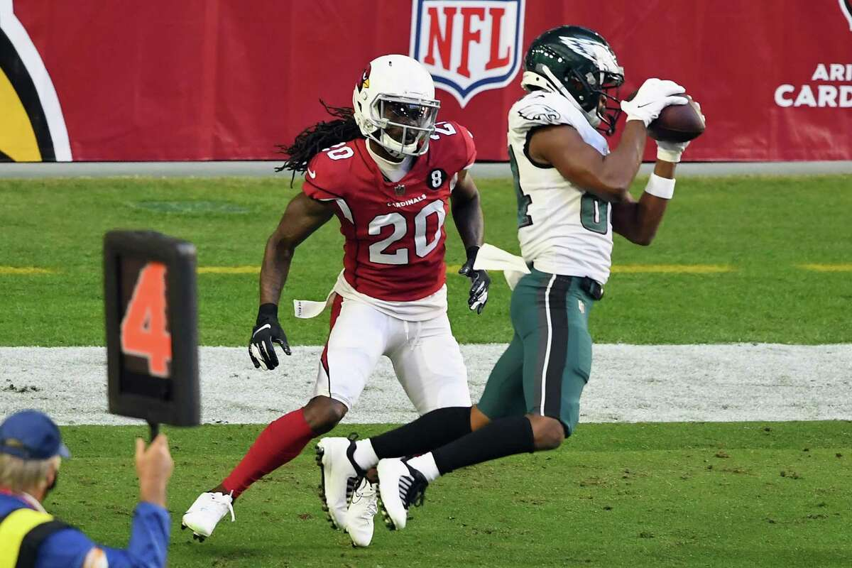 Greg Ward makes one of his two touchdown catches during the Eagles' loss to the Cardinals on Sunday in Arizona.
