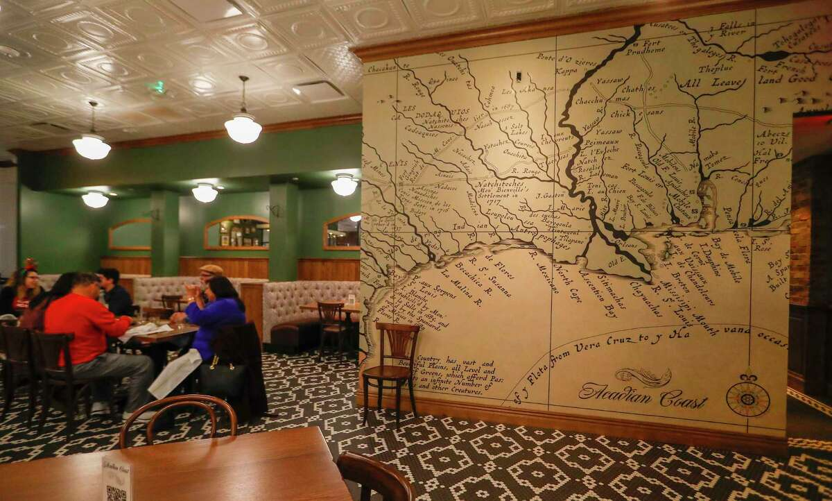 Interior dining area with a chart map on the wall at Acadian Coast, a new Cajun & Creole Gulf Coast seafood restaurant with a huge front patio, within shouting distance of Original Ninfa's and El Tiempo, Thursday, December 17, 2020, in Houston.
