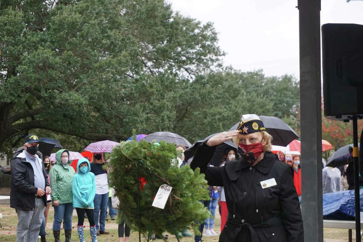 An honor wreath is saluted at Wreaths Across America on Saturday, Dec. 19, at Katy Magnolia Cemetery. The event placed 500 wreaths on the graves of United States military veterans.