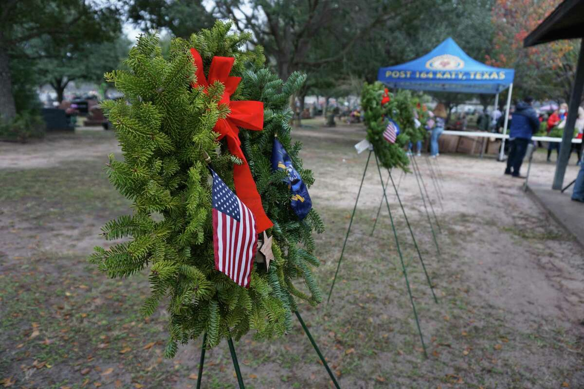 Honor wreaths representing the United States Army, Marine Corps, Navy, Air Force, Coast Guard, Merchant Marines, prisoners of war and those missing in action are displayed at Wreaths Across America on Saturday, Dec. 19, at Katy Magnolia Cemetery.
