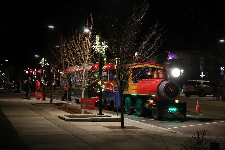 The Northern Star Railroad waits as it loads up with passengers downtown Midland Sunday night. The train was filled with families taking in the festive atmosphere of downtown Midland Photo: Doug Julian/for The Daily News