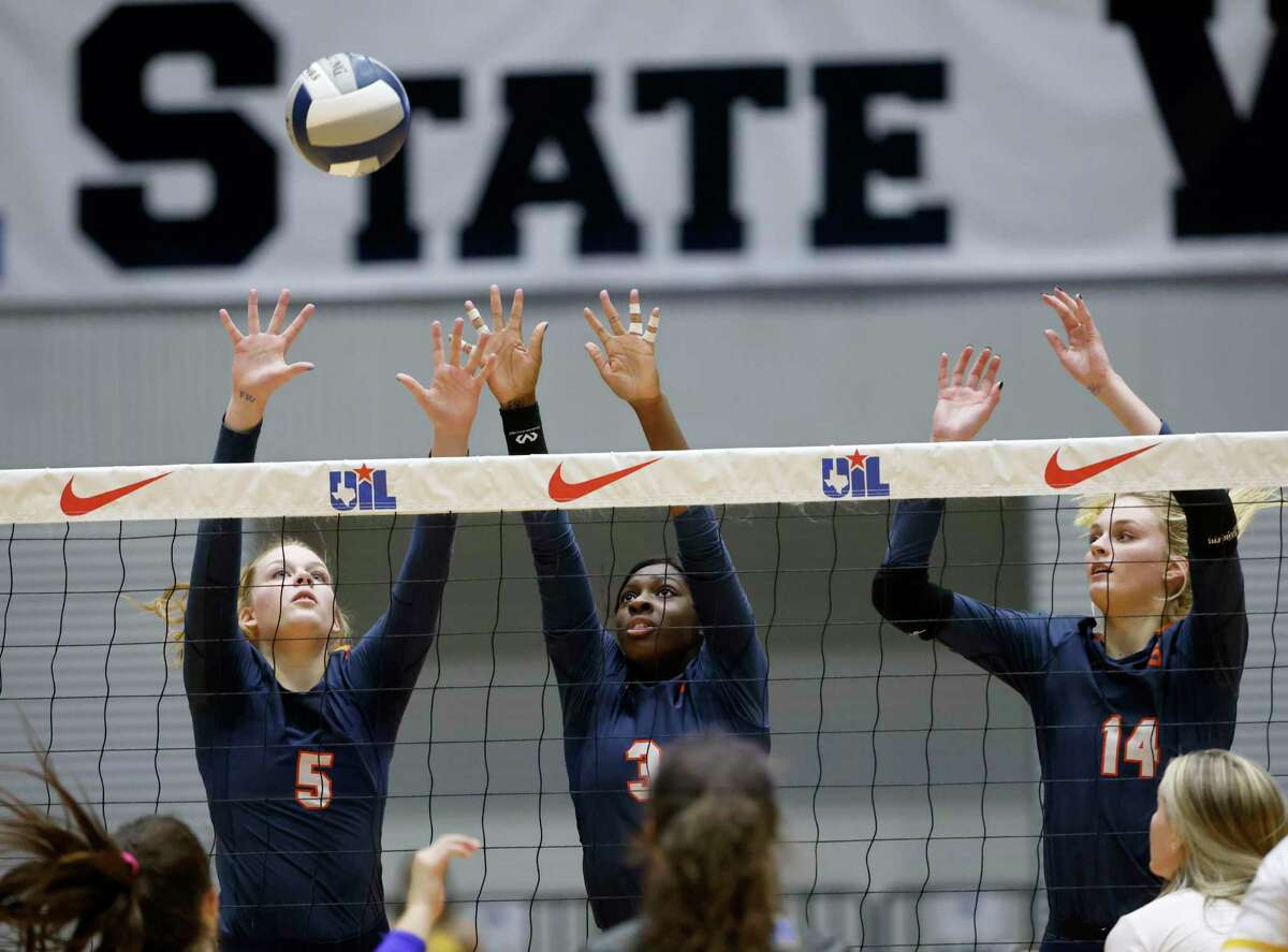 Seven Lakes players Casey Batenhorst (5), Mayo Olibale (3) and Ally Batenhorst (14) defend against Klein during the Conference 6A State High School volleyball championship in Garland, Texas on Dec. 12, 2020. (Michael Ainsworth/ Contributor)