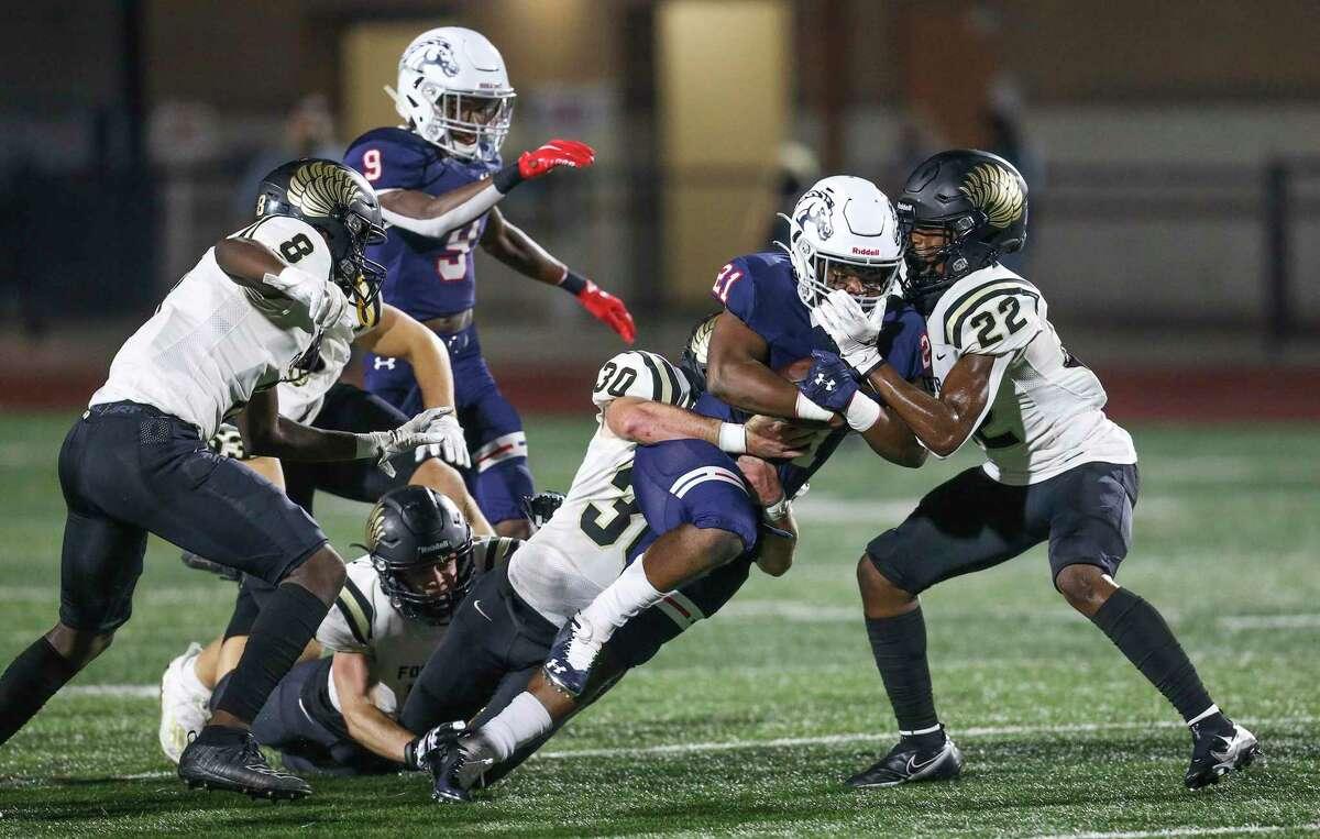 Manvel Mavericks running back De'monte' Seymore (21) is tackled by Foster Falcons linebacker Luke Capel (30) in the first half in a high school football game on November 13, 2020 at Alvin Memorial Stadium in Alvin, TX.