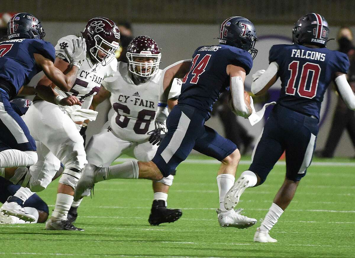 Tompkins defensive back Colby Huerter (14) returns a fumble for a touchdown during the first half of a 6A Division I Region III area round high school football playoff game, Friday, Dec. 18, 2020, in Katy, TX.