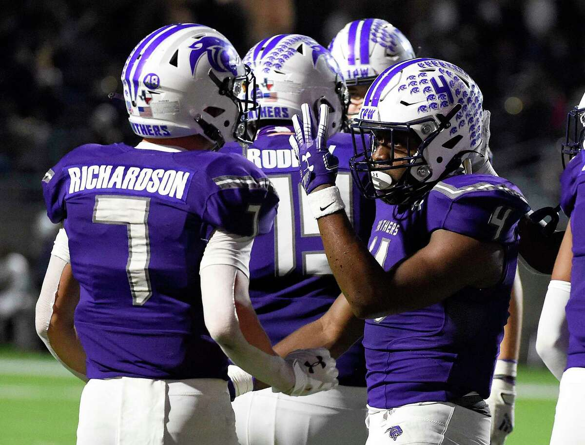 """Ridge Point running back Keith Jackson (4) signals """"Four"""" after scoring his fourth touchdown during the second half of a 6A Division I Region II area round high school football playoff game against Jersey Village, Saturday, Dec. 19, 2020, in Katy, TX."""