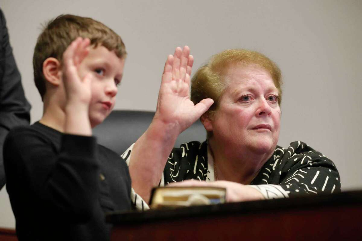 Marsha Porter, right, is sworn into Conroe City Council beside her seven-year-old grandson, Hunter Biller, at Conroe Tower Tuesday, Dec. 22, 2020, in Conroe. The former Conroe councilwoman won the seat over Kelley Inman following a runoff election on Dec. 15. Porter fills unexpired term of newly-elected Mayor Jody Czajkoski. Only 2,197 out of 49,155 registered voters cast a ballot in the runoff with Porter receiving 1,367 of those votes to Inman's 826.